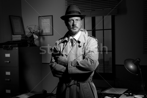 Film noir: detective holding a revolver and posing Stock photo © stokkete