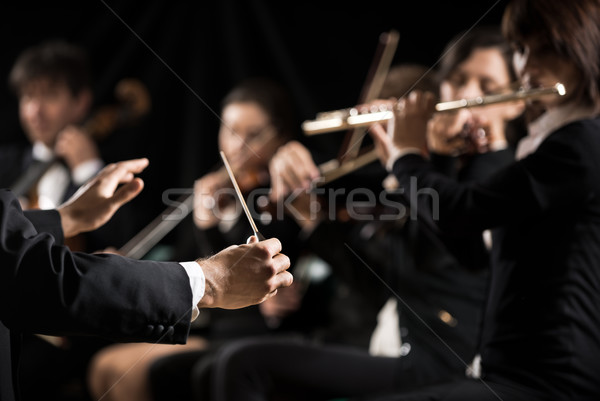 Stock photo: Conductor directing symphony orchestra