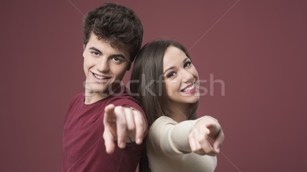 Happy young couple pointing Stock photo © stokkete