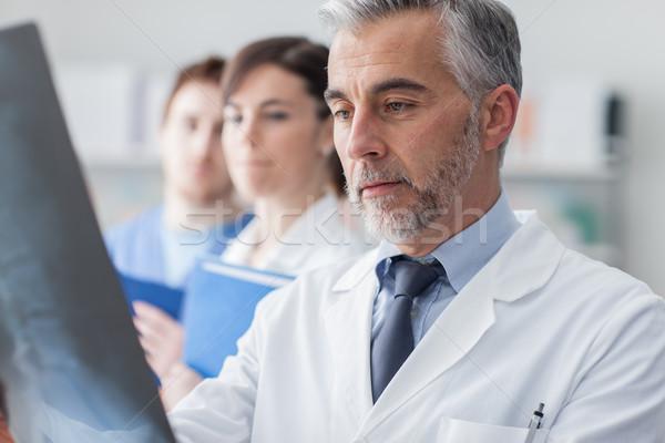 Medical team examining an x-ray Stock photo © stokkete