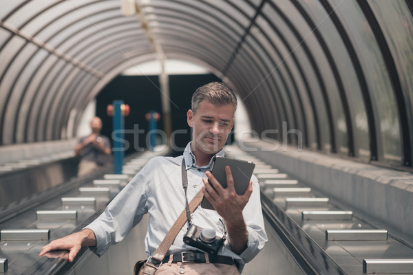 Man with tablet on the escalator Stock photo © stokkete
