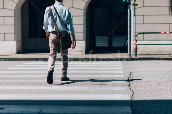Man crossing the street Stock photo © stokkete