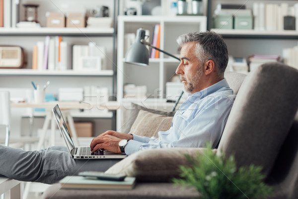 Businessman working at home Stock photo © stokkete