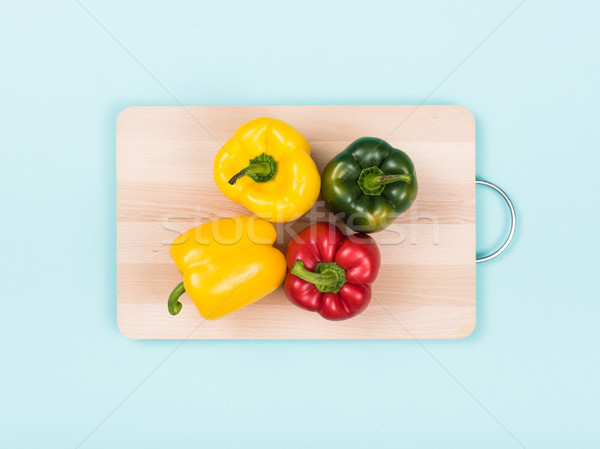 Fresh bell peppers on a chopping board Stock photo © stokkete