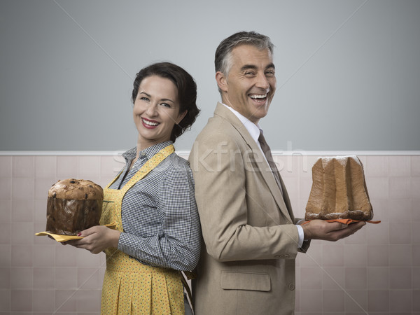 Smiling couple at home with christmas cakes Stock photo © stokkete