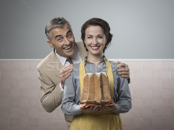 Smiling vintage couple with cake Stock photo © stokkete