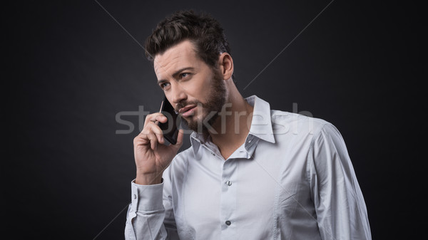 Young businessman having a phone call Stock photo © stokkete