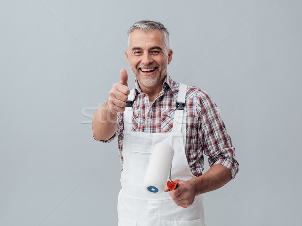Painter giving a thumbs up Stock photo © stokkete