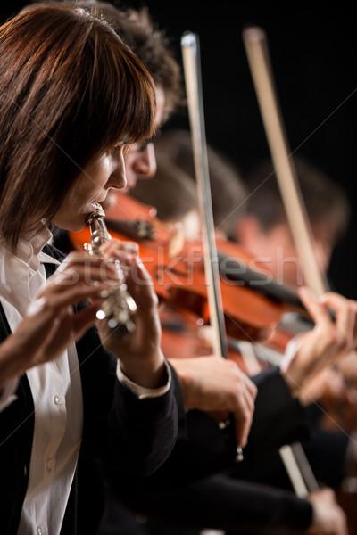 Female flutist performing Stock photo © stokkete