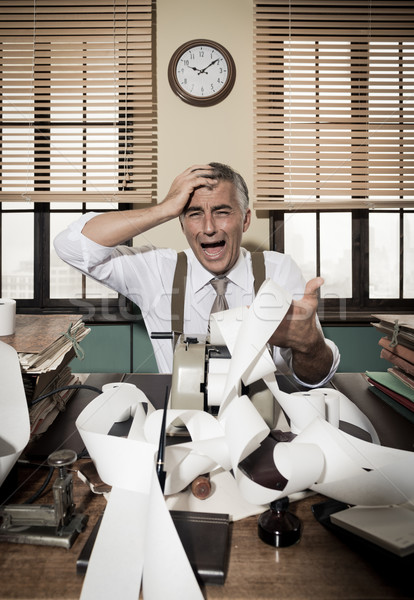 Desperate vintage accountant at desk Stock photo © stokkete