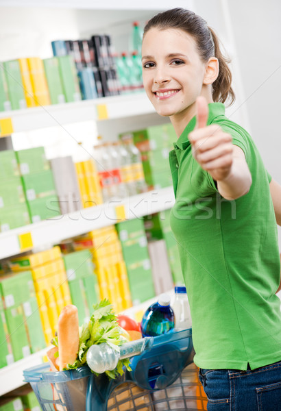 Woman thumbs up at supermarket Stock photo © stokkete