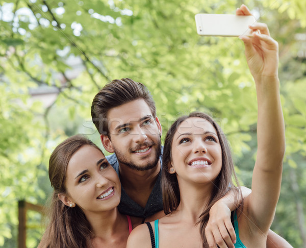 Cheerful teens at the park taking selfies Stock photo © stokkete