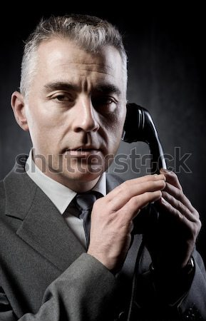 Cool undercover agent with gun Stock photo © stokkete