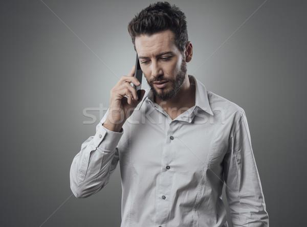 üzletember telefon vonzó beszél szolgáltatás fiatal Stock fotó © stokkete