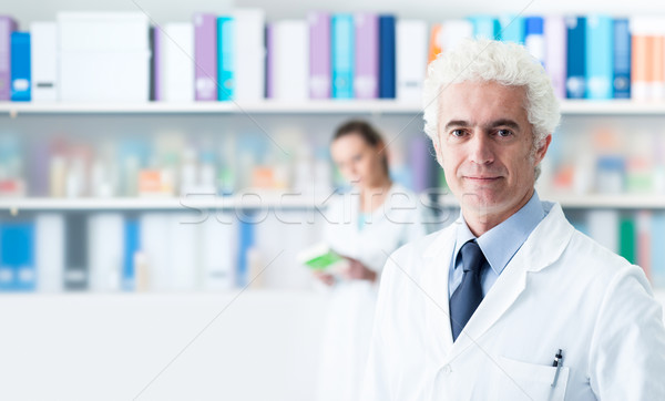 Stock photo: Confident doctor posing in his office