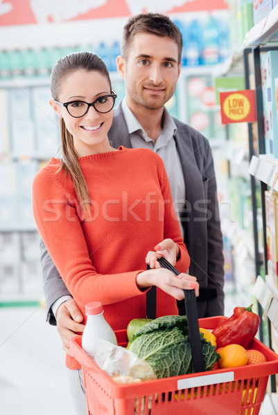 Happy couple shopping at the store Stock photo © stokkete
