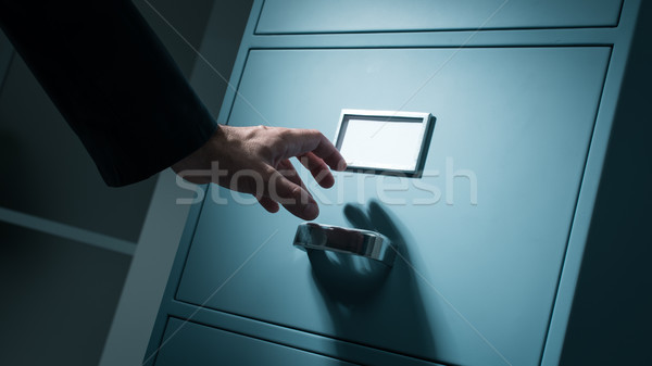 Office worker searching confidential information Stock photo © stokkete