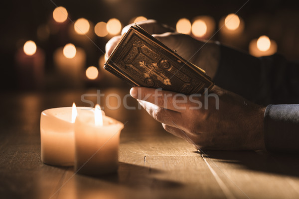 Man reading the Holy Bible and praying in the Church Stock photo © stokkete