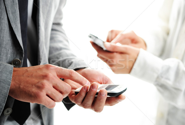 businesspeople text message on their mobile phones Stock photo © stokkete