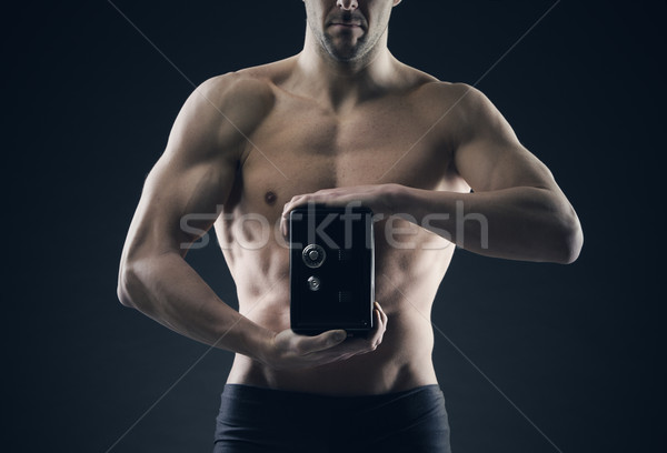 Muscular man protects savings in the safe Stock photo © stokkete