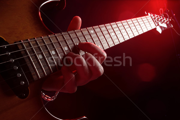 Stock photo: guitar player in action on stage