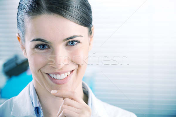 Female researcher smiling confidently Stock photo © stokkete