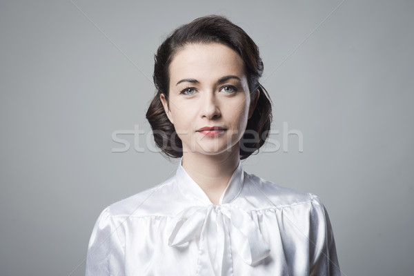 Attractive woman with vintage hairstyle Stock photo © stokkete