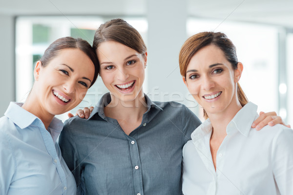 Female office colleagues posing together Stock photo © stokkete