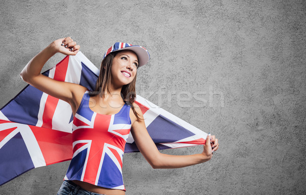 Cheerful English girl with a flag Stock photo © stokkete