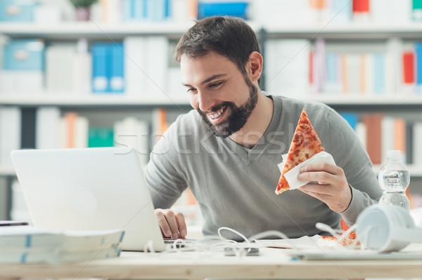 男 昼休み 笑みを浮かべて オフィス 食べ ストックフォト © stokkete