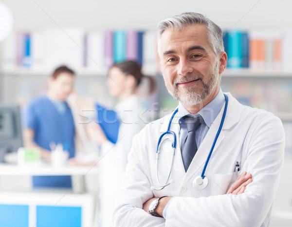 Confident doctor posing in the office Stock photo © stokkete