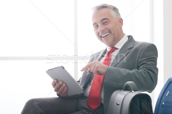 Işadamı bekleme odası gülen oturma dijital Stok fotoğraf © stokkete
