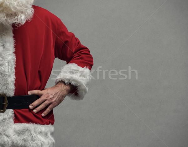Confident Santa posing with arms akimbo Stock photo © stokkete
