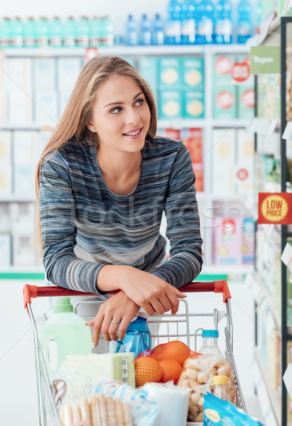 Young woman at the supermarket Stock photo © stokkete