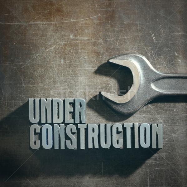 építkezés felirat fémes textúra terv fém Stock fotó © stokkete