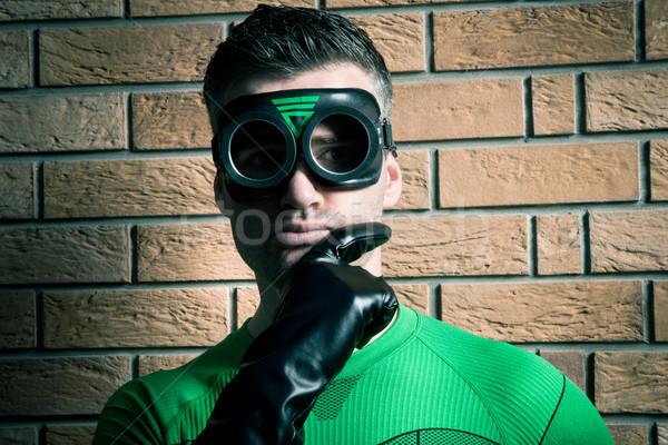 Confident superhero against a brick wall Stock photo © stokkete