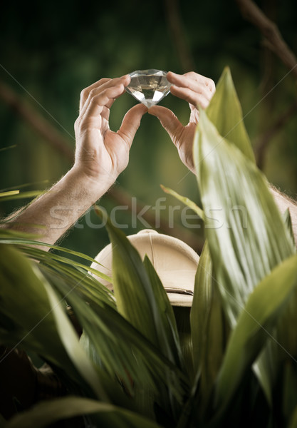 Explorer finding a huge gem in the jungle Stock photo © stokkete