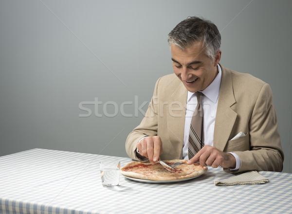 ビジネスマン 昼休み 笑みを浮かべて エレガントな ピザ リラックス ストックフォト © stokkete
