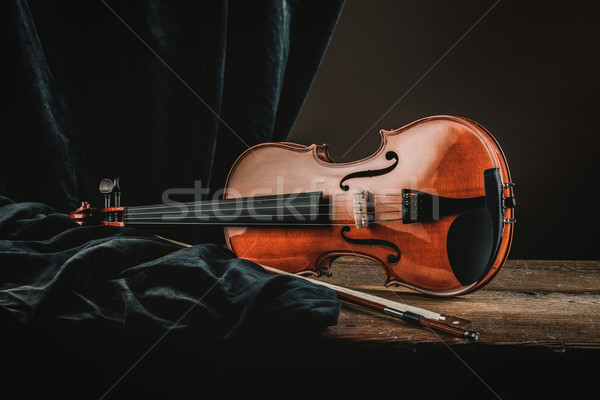 Violin on an old table still life Stock photo © stokkete
