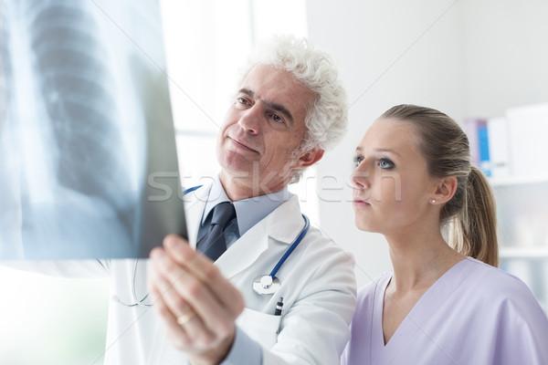 Doctors examining an x-ray image Stock photo © stokkete