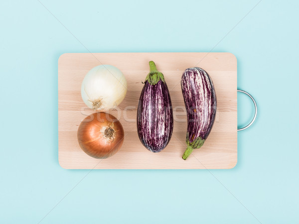 Eggplants and onions on a cutting board Stock photo © stokkete