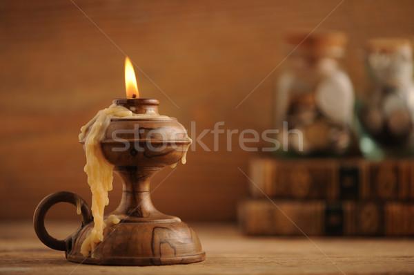 Vieux bougie table en bois livres bois art Photo stock © stokkete