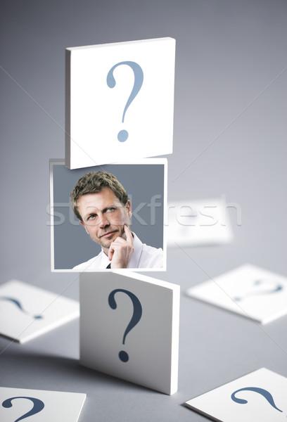 Zamyślony człowiek portret mylić biznesmen znaki zapytania Zdjęcia stock © stokkete