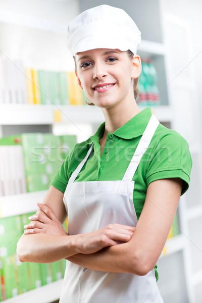 Smiling supermarket worker amrs crossed Stock photo © stokkete