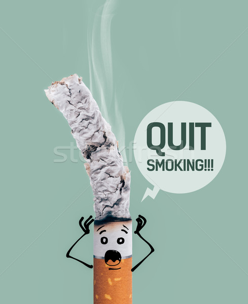 Stock photo: Burning cigarette and funny character
