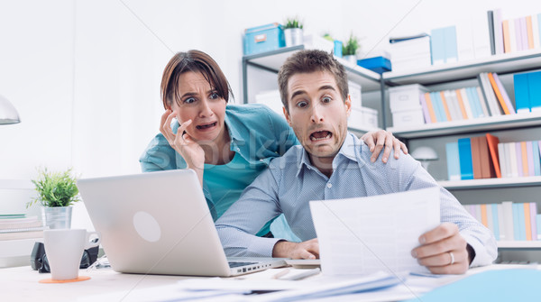 Stressed couple checking bills Stock photo © stokkete
