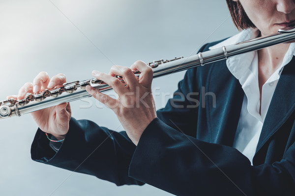 Professional flutist solo player Stock photo © stokkete