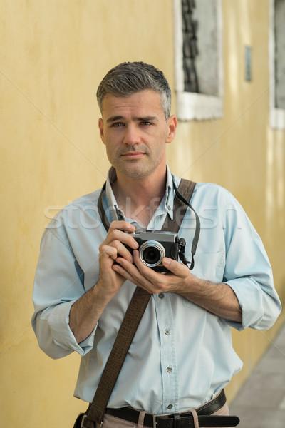 Photographer exploring a city Stock photo © stokkete