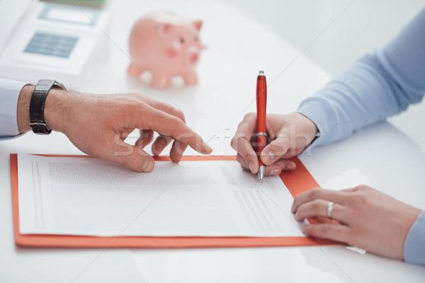 Pénzügyi tervezés nő aláírás szerződés pénzügyi tanácsadó mutat Stock fotó © stokkete