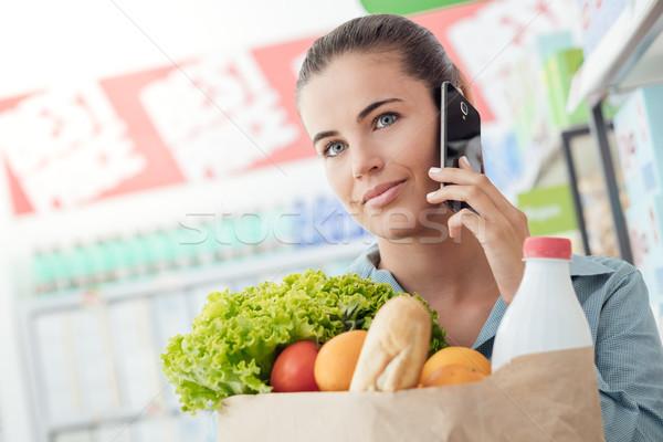 Stock fotó: Telefon · hív · áruház · gyönyörű · fiatal · nő · élelmiszer